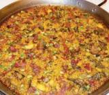 Img 1: Paella of Albufera duck and locally-grown baby vegetables