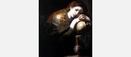 Mujer en expresión melancólica sobre fondo oscuro