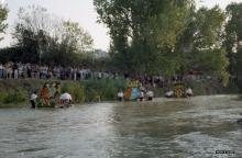 Ofrenda al Río Túria. Llegada de los escudos